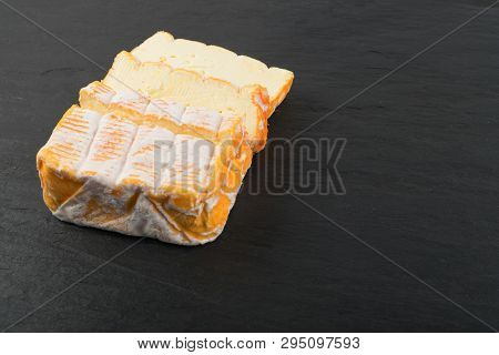 Cheeseboard With Sliced Yellow Cheese Close Up
