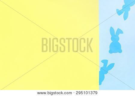 Paper Easter Bunny On Yellow And Blue Background. Top View, Copy Space, Flat Lay. The Concept Of Min