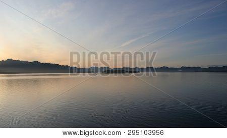 Sunset On A Tranquil Inside Passage In Alaska.