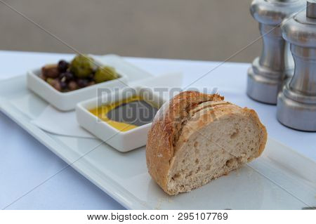 Bread Slices With Olive Oil And Balsamic Vinegar And Olives Entree, Starter Meal At Restaurant. Food