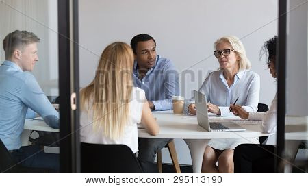 International Negotiators Or Diverse Office Staff Talking Negotiating In Boardroom