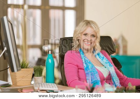 Young Professional Woman In Her Office Smiling Broadly