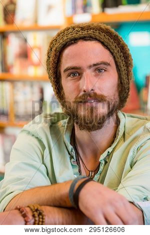 Handsome Young Man With Knit Cap In Book Store Or Library