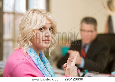 Woman In Pink Sweater Gesture Towards Incompetent Male Colleague