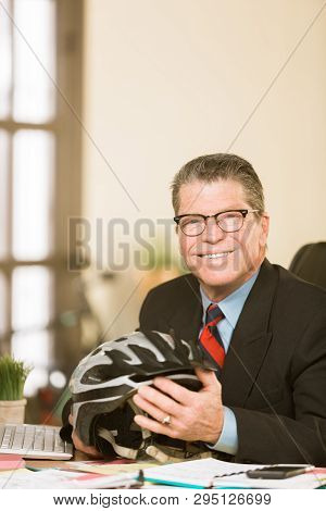 Handsome Professional Man Holding A Bicycle Helmet