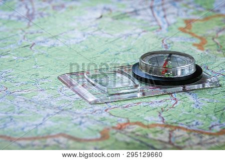 Compass On Paper Orienteering Map. Topography, Cartography And Geography.