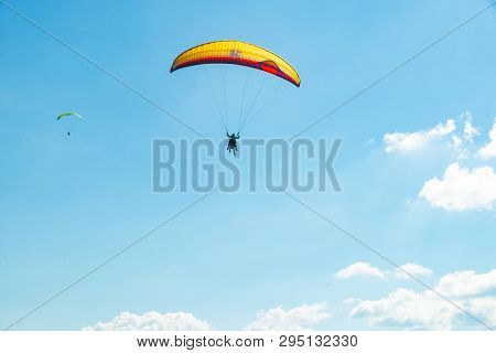 Mountains Leisure Activities. Paragliding. Summer Time. Landscape