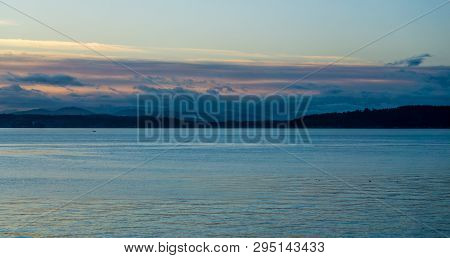 The Sun Sets On The Puget Sound In The Pacific Northwest.