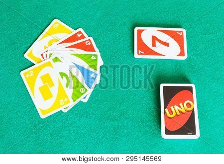 Moscow, Russia - April 3, 2019: Gameboard Of Uno Card Game On Green Baize Table. Uno Is Shedding-typ