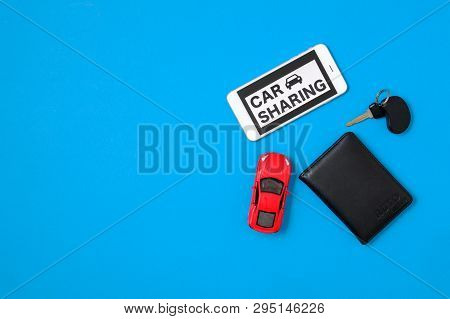 Car Sharing Concept With Toy Car, Auto Drive License, Car Key, Smartphone, Text Sign