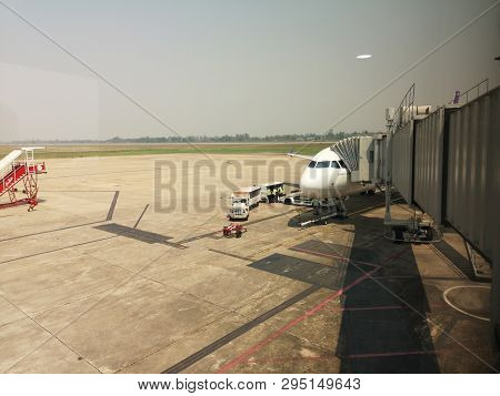 Chiang Rai, Thailand - March 29 : Aero Bridge Or Jetway Connecting To The Airplane At Airport On Mar