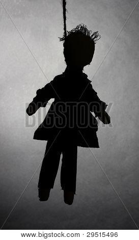 Hanged doll voodoo boy-groom on grey background
