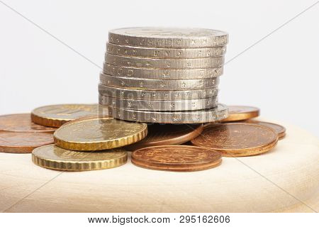 Euro Coins Stacked On Each Other In Different Positions. Selective Focus