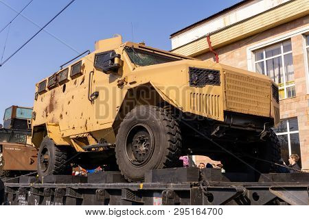 Perm, Russia - April 10, 1019: Armored Car Of Isis Militants With Holes In Armor, Seized As A Trophy