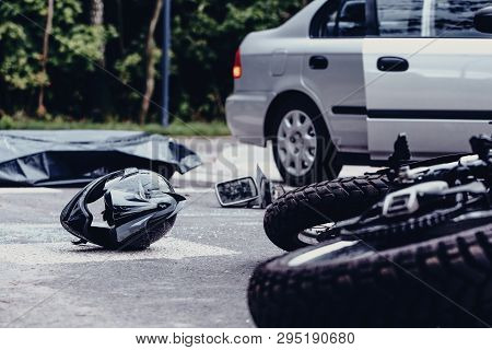 Motorcycle Helmet On The Street After Terrible Car Crash, Black Bag With Corpse And Car With Open Do