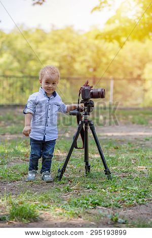 Two Years Old Boy Playing With Photo Camera