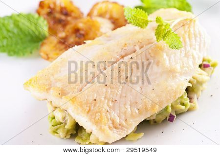 Fish fillet with avocado tatar