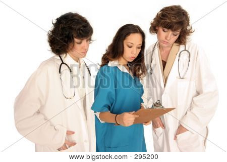 Medical Professionals Looking Over Report