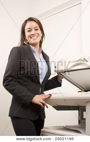 Pretty Businesswoman Making Copies