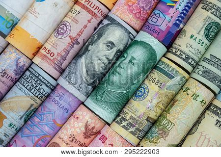 Us Dollar And China Yuan Banknote  With Multi Countries Banknotes. Its Is Symbol For Tariff Trade Wa
