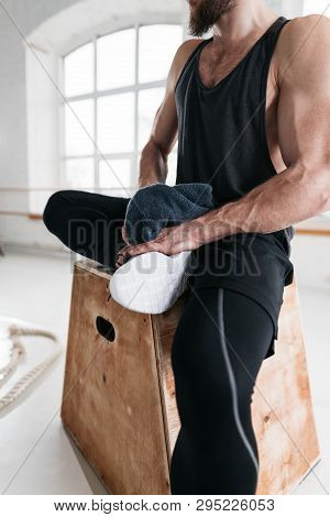 Close Up View Of Muscular Perspiring Man Resting After Hard Cross Workout In Gym. Sweaty Male Athlet