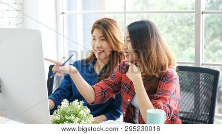 Two Young Asian Women Working With Computer At Home Office With Happy Emotion, Working At Home, Smal