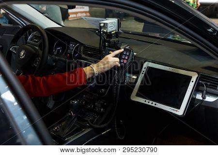 Prague, Czech Republic - April 13th 2019: Women Turn On Signal Light In Police Automobile Skoda Supe