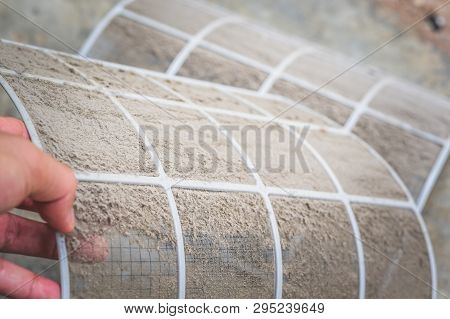 Close Up Dirty Dust On Air Conditioner Filter , Cleaning Or Changing The Filter In The Air Condition
