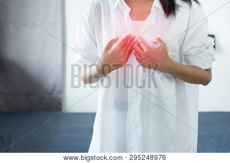 Asian Woman Having Or Symptomatic Reflux Acids,gastroesophageal Reflux Disease,because The Esophagea