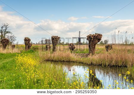 The Noordeveldse Windmill In The Dutch Village Of Dussen, North Brabant Is A Wooden Hollow Post Mill