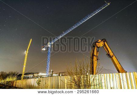 Construction Cranes, Nitra, Slovak Republic. Night Scene. Starry Sky.
