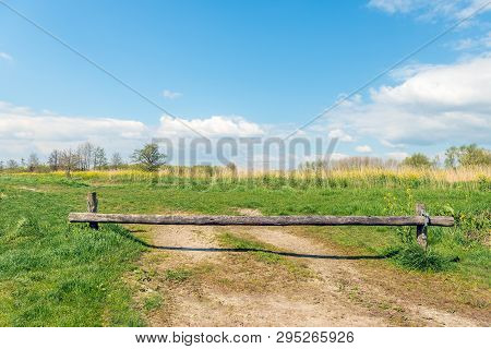 Wooden Beam Blocks Access To A Dutch Nature Reserve In The Spring Season.