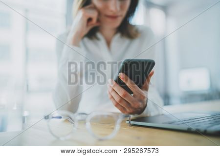 Business Woman Using Mobile Phone At Working Day In Office.blurred Background. Business Technology C