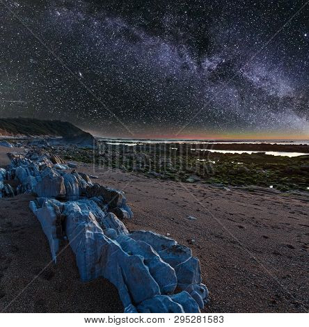 Night Ocean Coast View From Beach With Big Stones And Starry Milky Way In Sky (saint-jean-de-luz, Fr