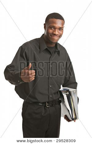 Friendly young black businessman holding binders on isolated white background