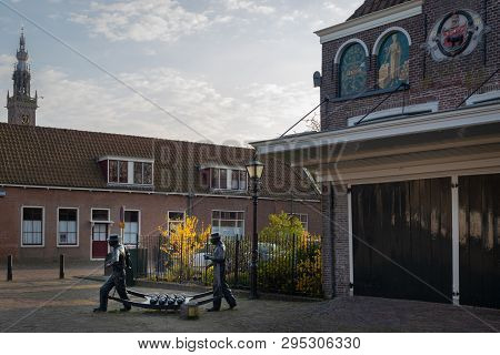 Edam, Netherlands - April 7, 2019: Statue Of Cheese Carriers At The Cheese Market In The Historic To
