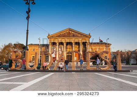 Budapest, Hungary - April, 2018: Tourists At The Budapest City Sign And The Budapest Hall Of Art  On