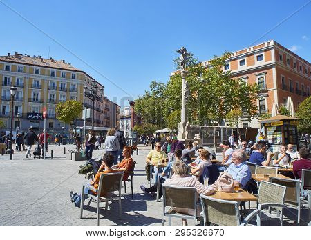 Madrid, Spain - April 12, 2018. People Refreshing On A Terrace In The Jacinto Benavente Square Of Ma