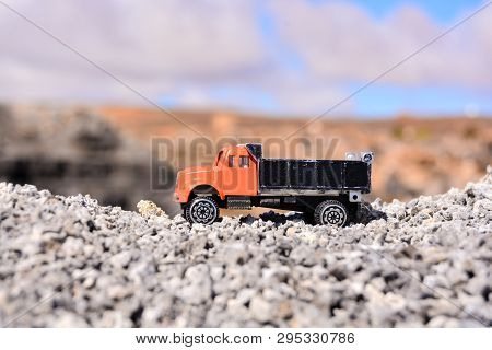 Conceptual Photo Picture Of A Toy Car In The Dry Desert