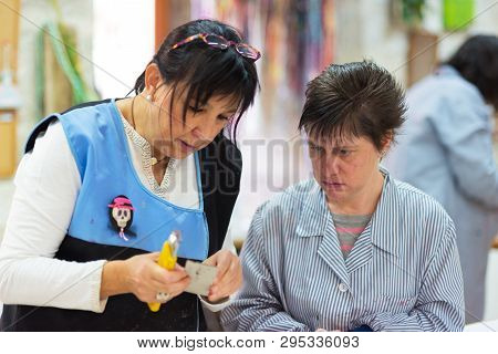 Briviesca, Spain - November 7, 2018: People With Special Needs Or Disability Working With Their Teac
