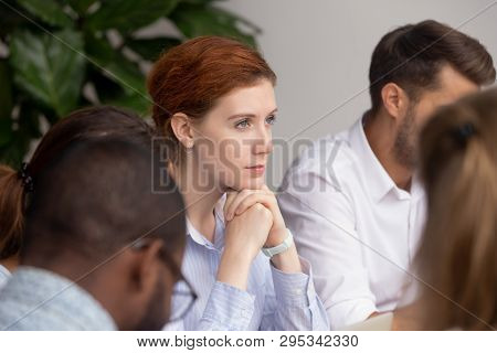 Thoughtful Businesswoman Thinking Of Business Challenges Opportunities At Group Meeting