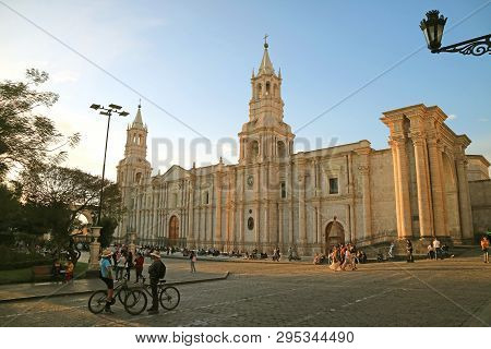 Cathedral Of Arequipa On The Lively Plaza De Armas Square With Many Visitors  In The Evening, Arequi