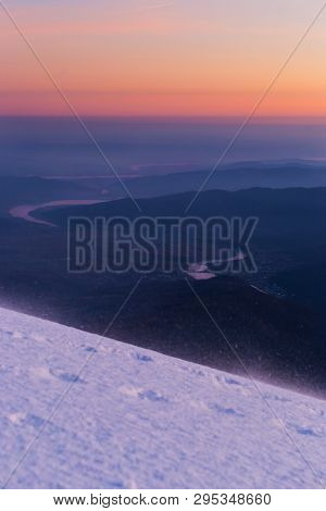 Picturesque Sunset From Cozia Mountain During Winter