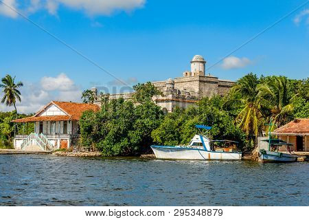 Jagua Spanish Fortress Fortified Walls With Trees And Fishing Boats In The Foreground, Cienfuegos Pr