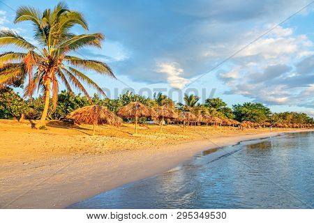 Rancho Luna Caribbean Beach With Palms And Straw Umbrellas On The Shore, Cienfuegos, Cuba