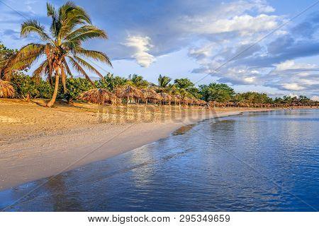 Rancho Luna Caribbean Beach With Palms And Straw Umbrellas On The Shore, Cienfuegos, Cuba
