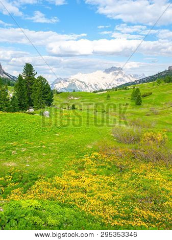 Landscape Of Dolomites With Green Meadows, Blue Sky, White Clouds And Rocky Mountains