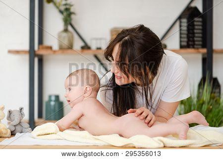 Happy Smiling Mom Hug Naked Infant Girl