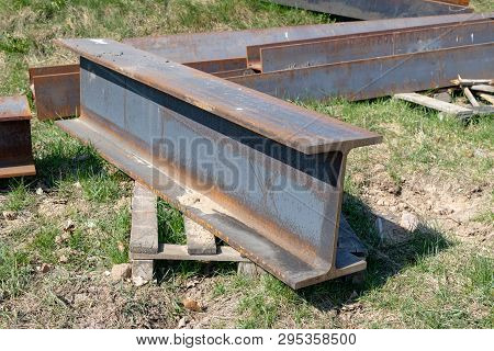 Large Steel I-sections On The Construction Site. Poorly Stored Building Materials. Season Of The Spr