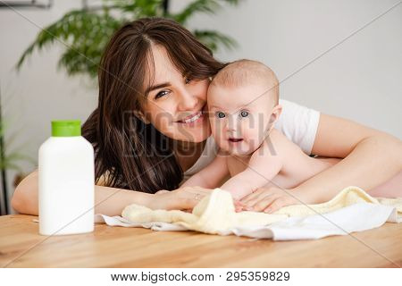 Portrait Of Mother And Infant With Lotion